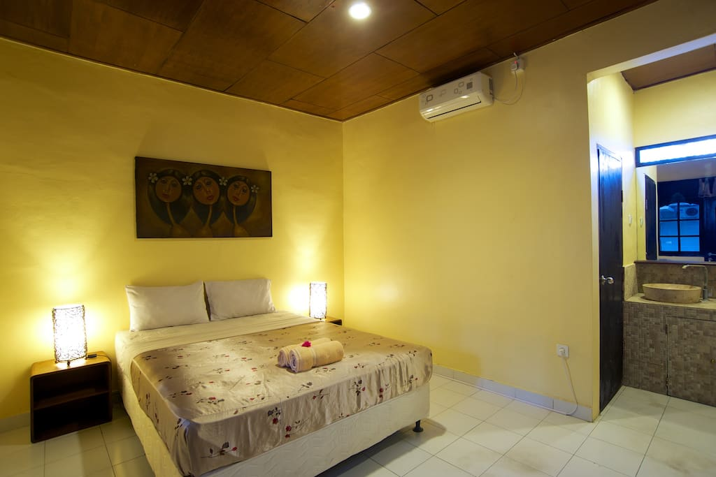 FREE Breakfast, Large Flatscreen Satellite TV, New Comfortable Queen Bed, Large Window, Bedside Tables, Rattan Lamps. Local Balinese Artwork. Daily Cleaning is included. Towels, Toilet Paper and Soap are also included.