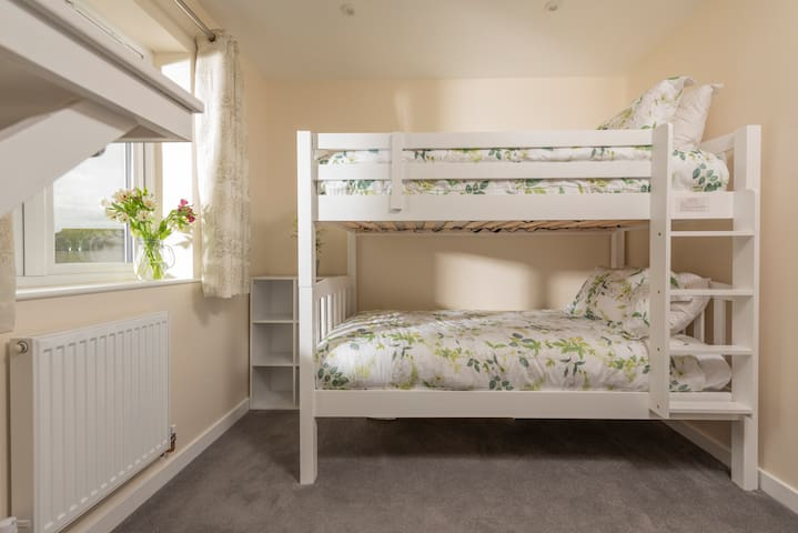 The bunk beds are  adult size and very comfortable in deed.  This picture does not really do them justice!  There is also a remote control smart TV and en suite bathroom with a large 1200mm walk in shower. Charging points and hanging space provided
