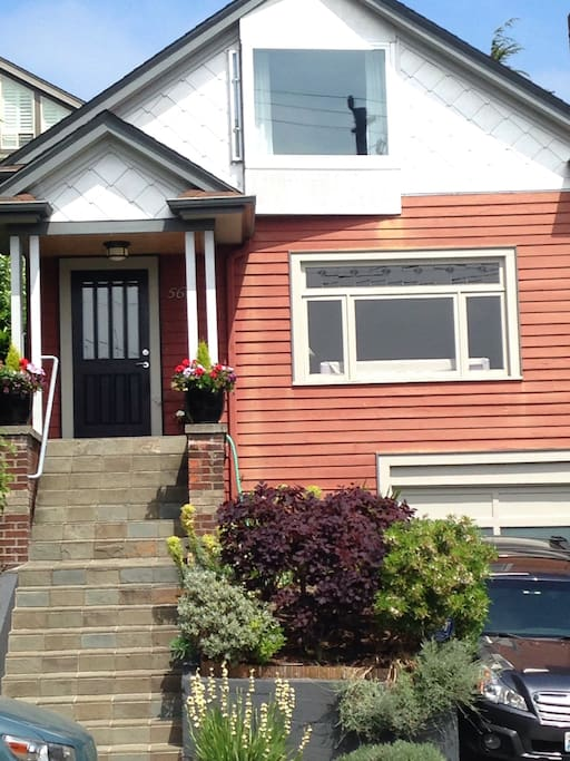 1924 completely renovated craftsman home. Entire lower level including sitting area, bedroom area, bathroom, and office is The AirBnB.