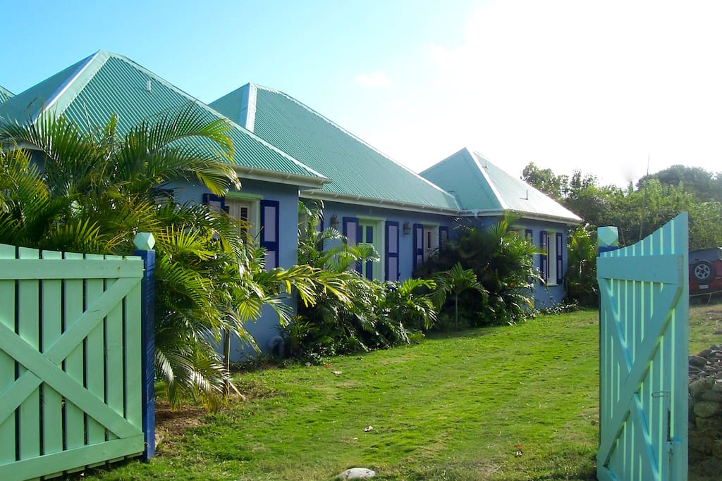 drive into whimsea house's front yard car park to begin a restful stay on nevis