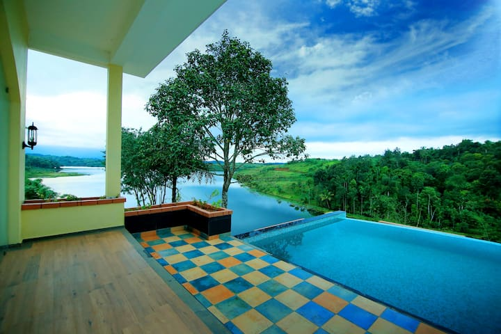 View to the Karapuzha lake from the infinity pool.