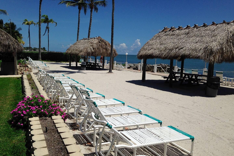 Continental Inn Private Beach, Lounge Chairs and Tiki Huts