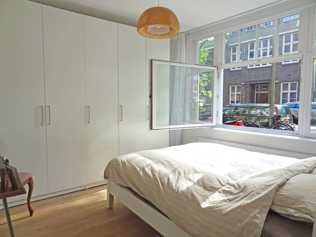 Bedroom with double glass, blackout curtains, wardrobe and 1.60/2.00 bed with premium mattress.