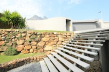 perched upon the slopes of the Table Mountain National Park, between Lions Head and the Twelve Apostle's Mountains,