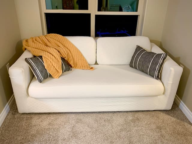 Incredibly soft, cozy couch that pulls pit into a sleeper sofa. Mattress topper & sheets provided in the closet.
