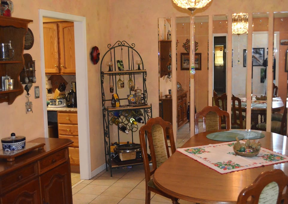 Dining room with European decor, access to kitchen and large table for dining or working on your laptop.