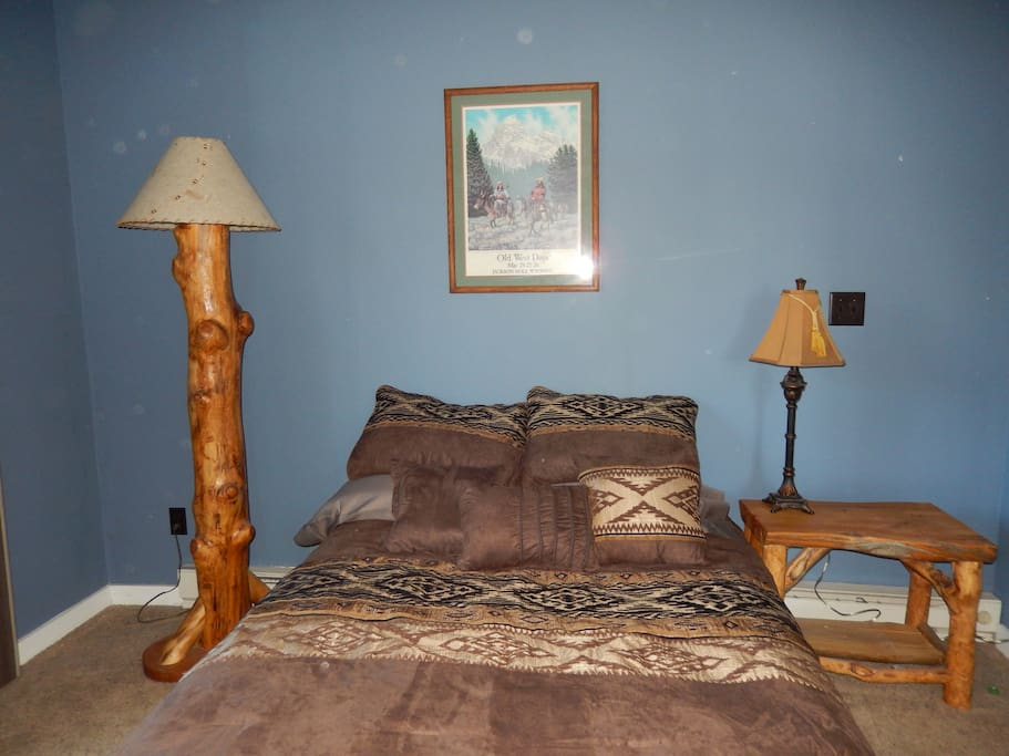 Nice sized bedroom with full size bed, closet and dresser.