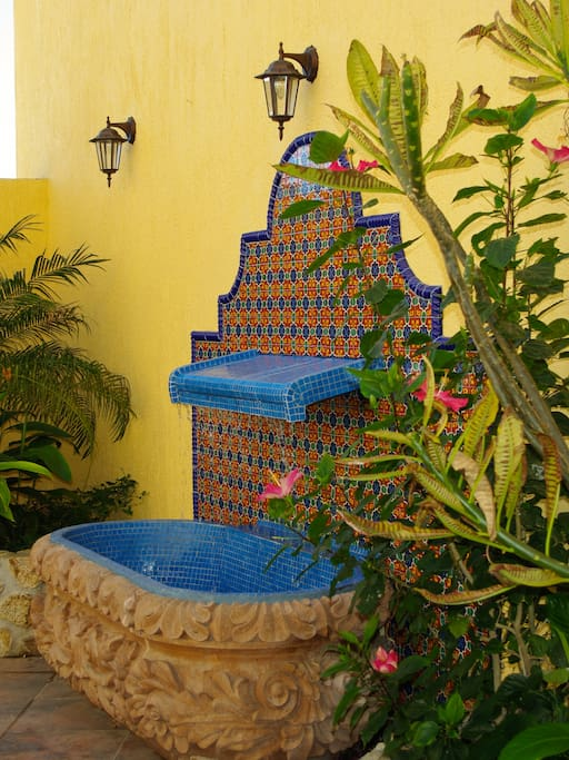 Listen to Casa Amistad's hand carved cantera fountain.
