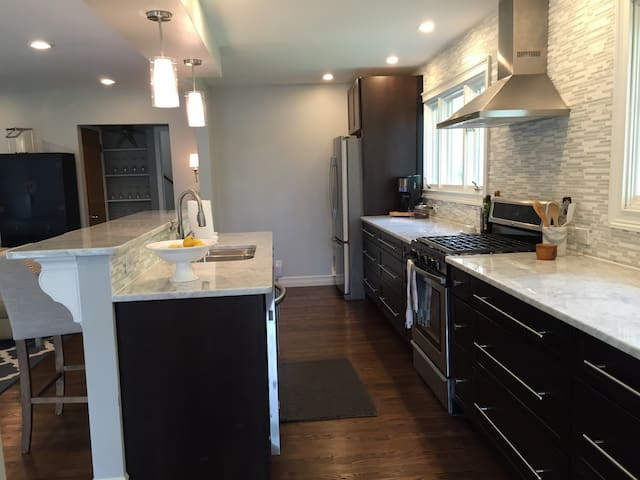 20' kitchen with marble countertops & stainless steel applicances