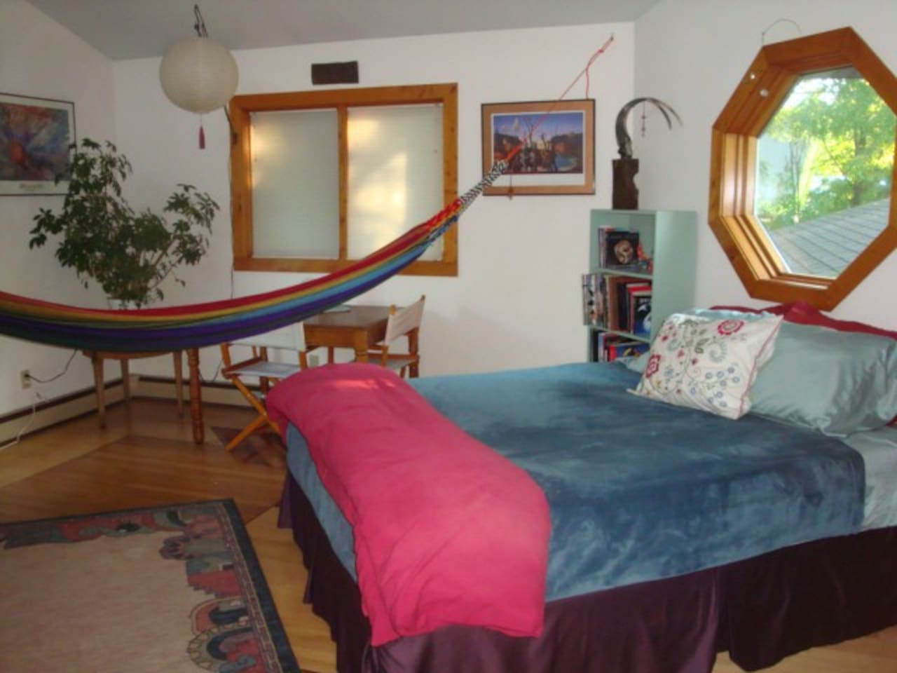 Queen room with hammock and natural light from all four directions.