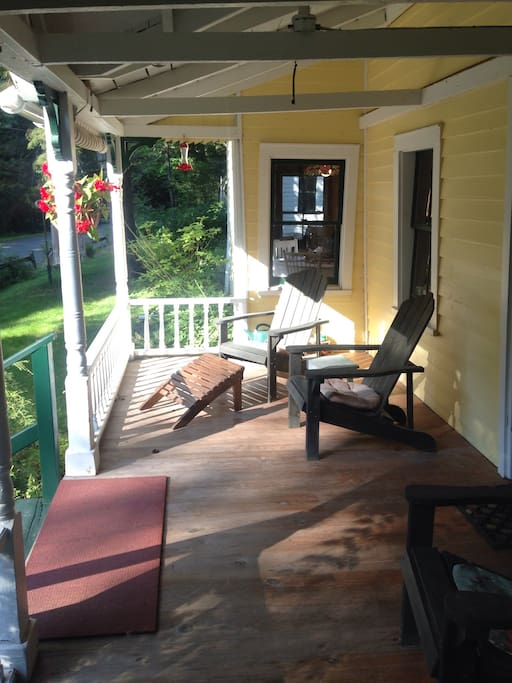 Front porch with four Adirondack chairs. You can hear the relaxing sound of Mongaup Creek from the porch, even in the middle of the winter!