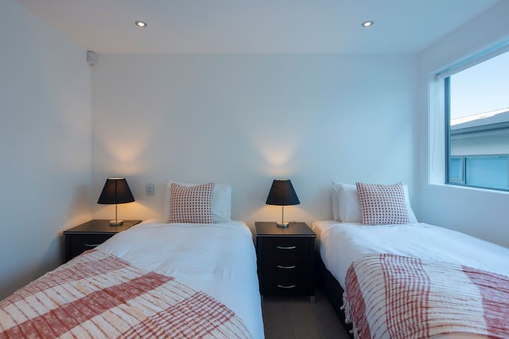 The fifth bedroom comes furnished with a mini walk-in wardrobe, drawers, mirror, high powered floor fan and extra blankets