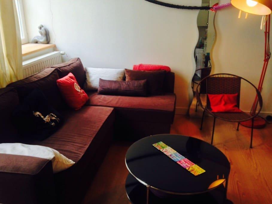 Salon, canapé-lit d'angle avec banquette.