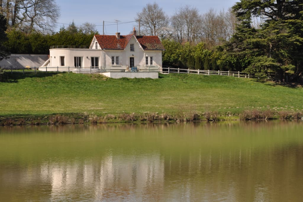 Beautiful house overlooking its own 7 acre lake set in 50 acres