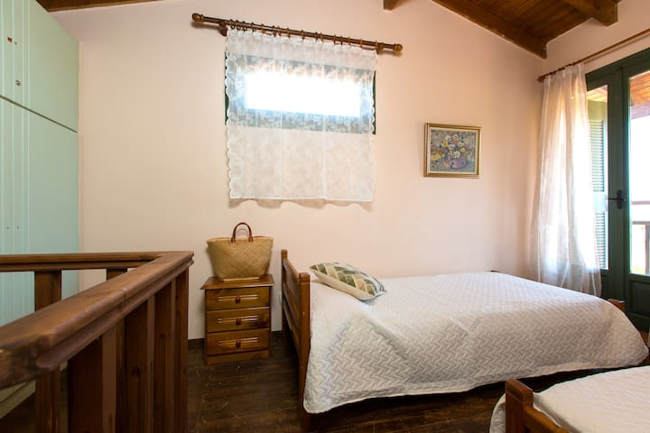 Bedroom with 2 single beds on the loft (attic)