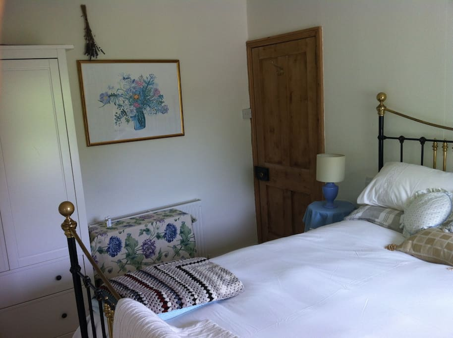 Bedroom 1 antique brass king bed.