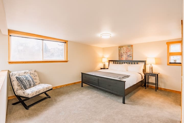 King size bed in open air loft on 3rd level
