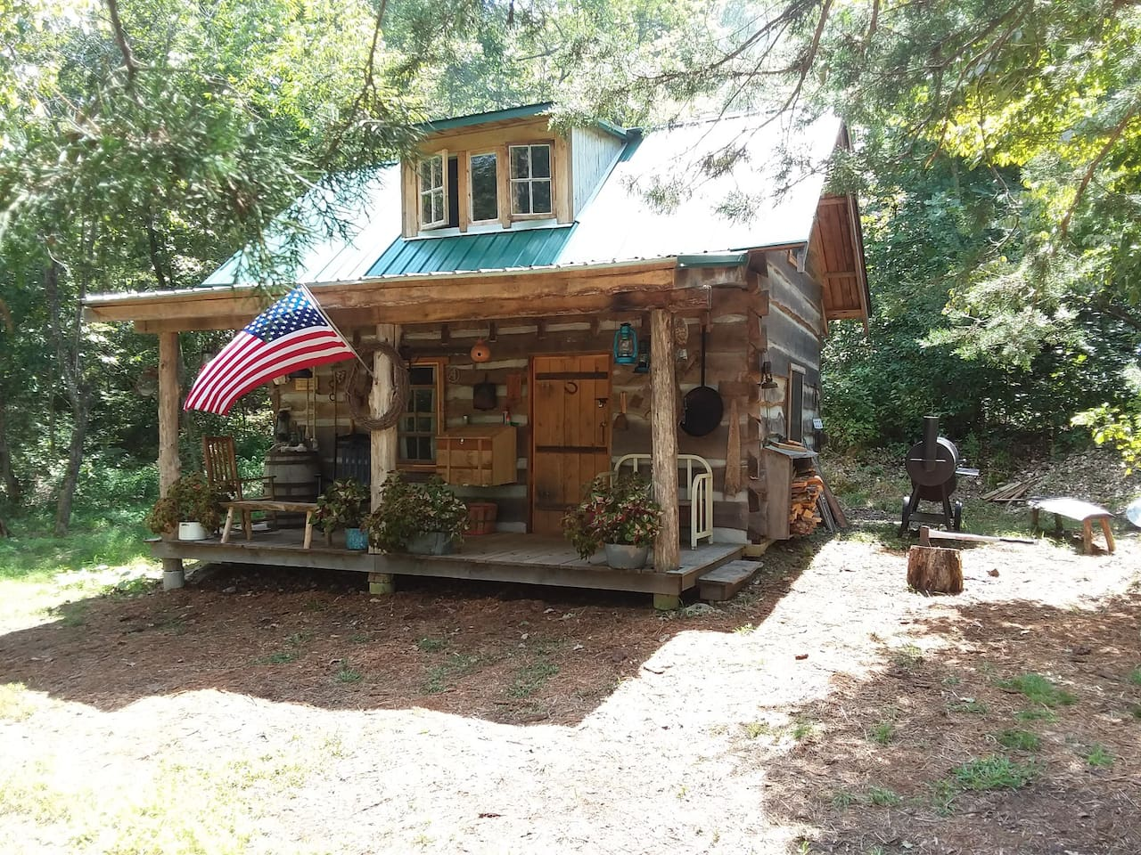 Nestled deep in the Ozark forest is this solid oak, hand-built cabin. Plan a quiet getaway today!