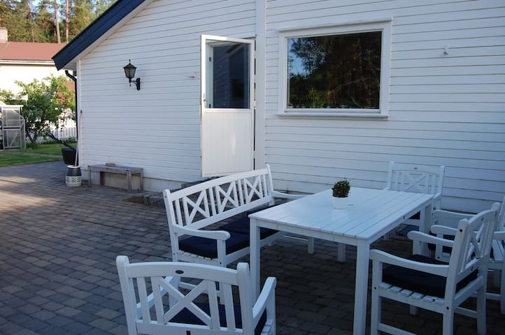 Seating area back of the house to enjoy a drink and dinner