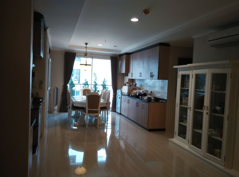Dining room, view from Living Room, there is Balcony with pool view
