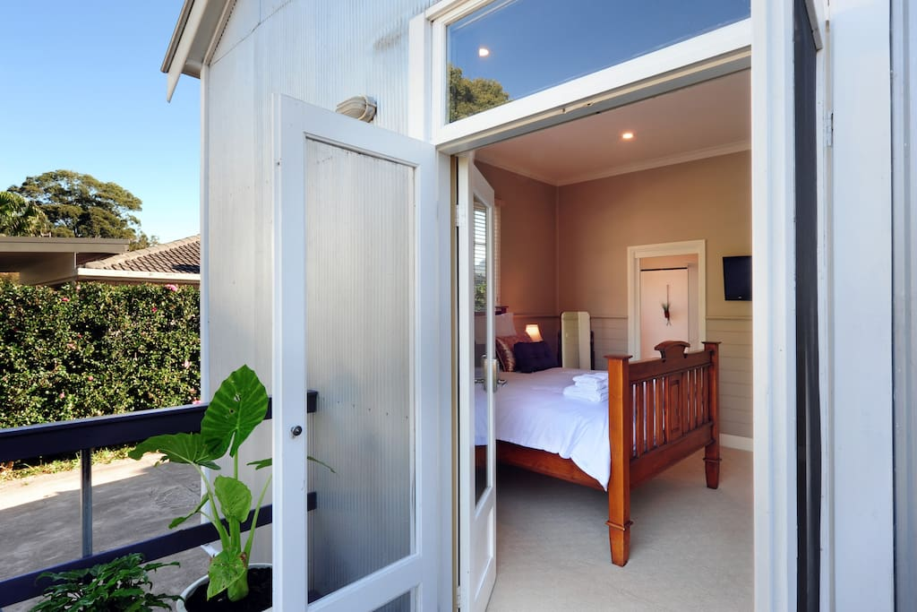 Rear entrance through a set of French doors into your private bedroom