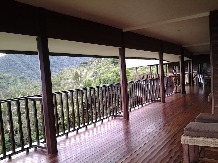Expansive wooden deck balcony in jungle surrounds