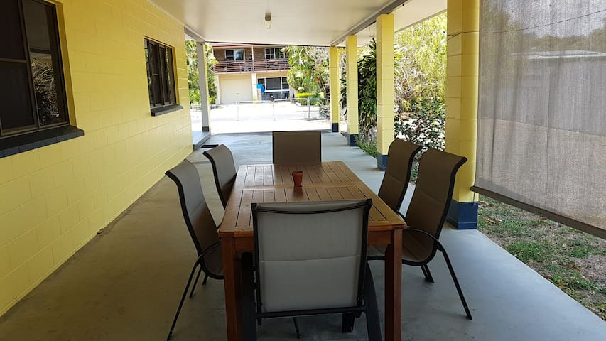 Large outdoor table with very comfy chairs.   There's nothing like freshly caught fish on the BBQ for dinner!