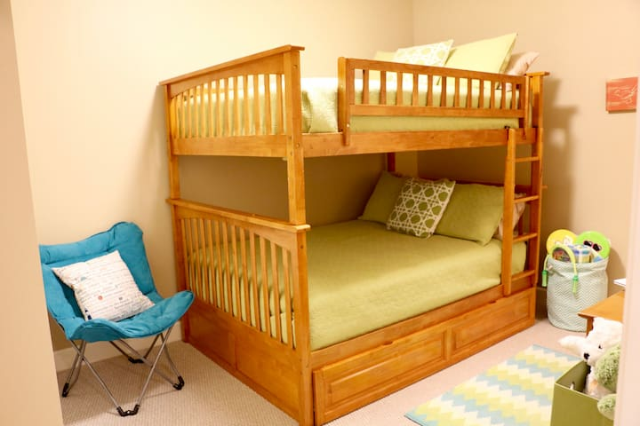 Third Bedroom, has Full Size Bunk Beds, a Full Closet with hangers and an extra dresser.