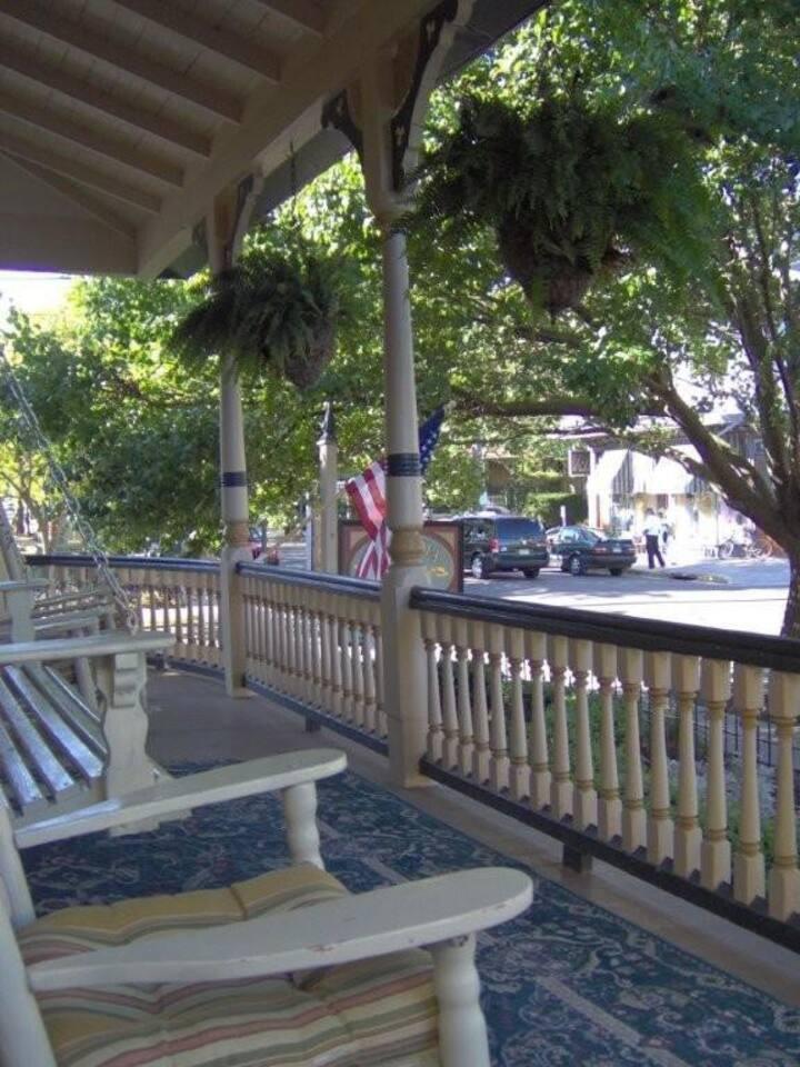 Front porch with rockers and swing (common area). Quiet corner lot with ocean breezes. Overlooks neighboring B&Bs.