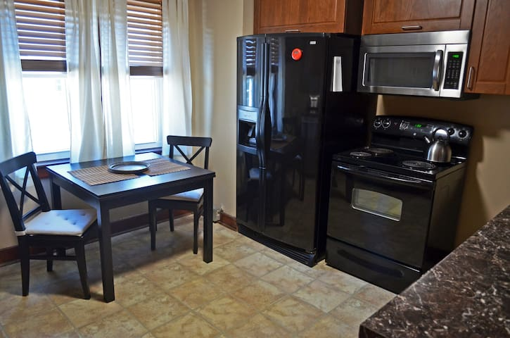 Kitchen has expandable table and four chairs, electric stove, full size refridgerator with freezer, ice maker, dishwasher and good counterspace.