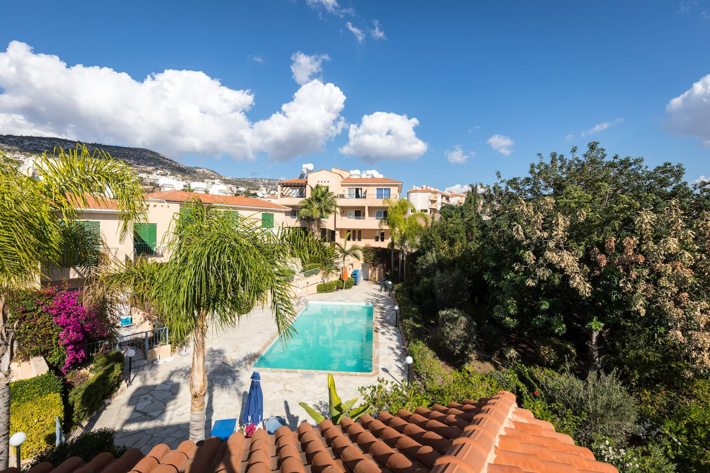 Relax in beautiful mature private gardens with a shared pool