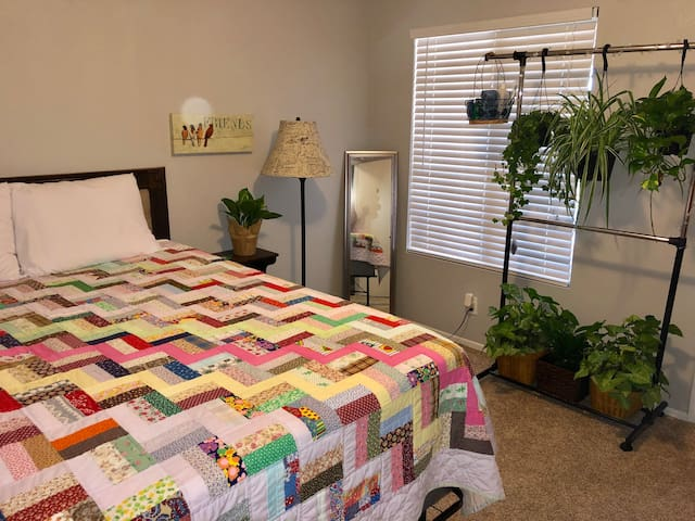 The main spacious guest bedroom can situate up to two adult guests. There is plenty of space for storage under the bed. The room overlooks the front patio and front yard.
