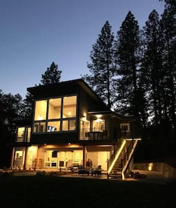 New contemporary home overlooking Rollins Lake.
