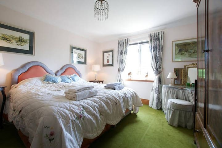 Double bedroom on 1st floor. Can be 2 single beds. Full breakfast. WiFi. View to Plora south. Adjacent large wet room/shower. ( can be shared with friends in another double room - only if occupied)