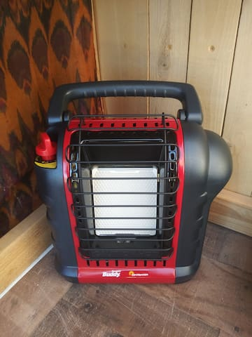 Buddy space heater. Bring your own 1 pound propane canisters to use it. One canister will last about 5 hours on the low setting which is enough for sized space. 2 hours on the high setting.