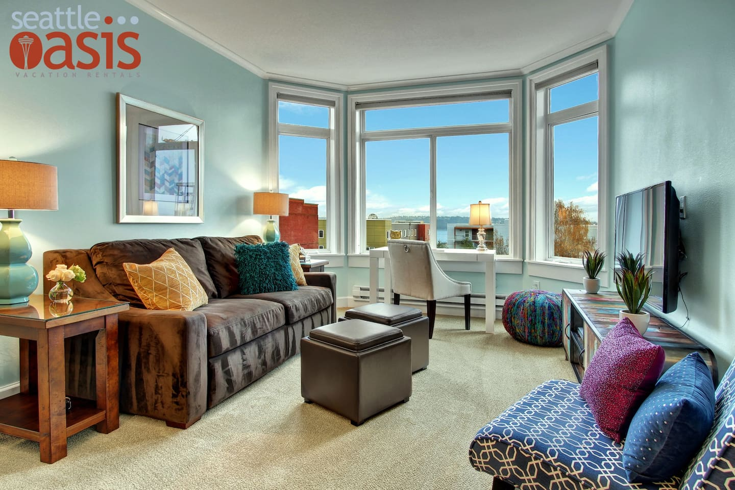 Enjoy an amazing view of Elliot Bay from the comfort of vibrant living room!