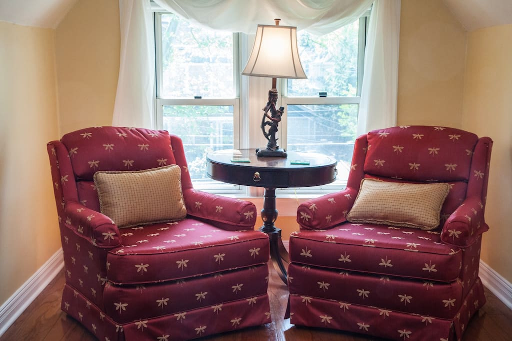 The Mellor House Guest Room 3:  Comfy reading chairs in front of south-facing windows.