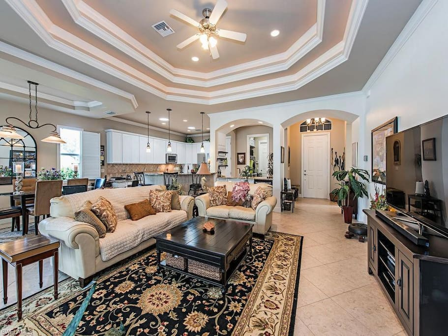 spacious living room area with large TV