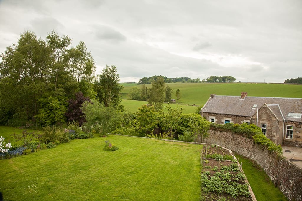 Our large garden provides views of the surrounding countryside. All you need to relax.
