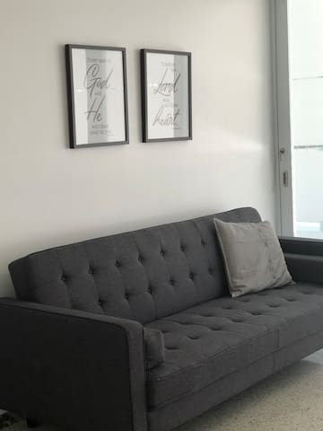 Living room area with sofa bed.
