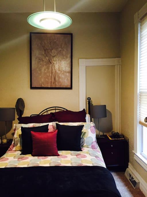 guest bedroom on main floor with queen bed