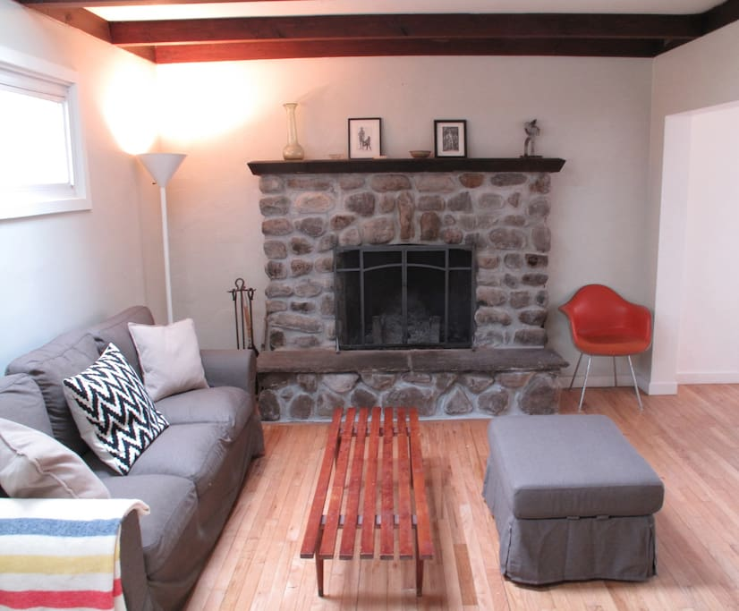 Hand-built stone fireplace in the living room