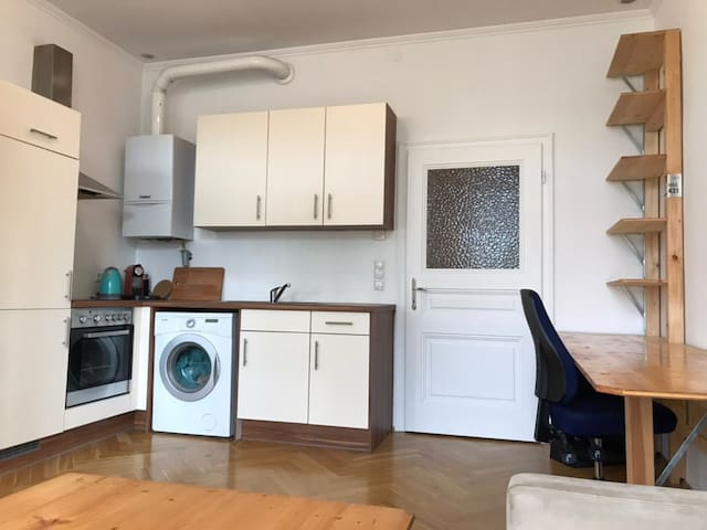Cosy apartment with homemade wooden furniture!