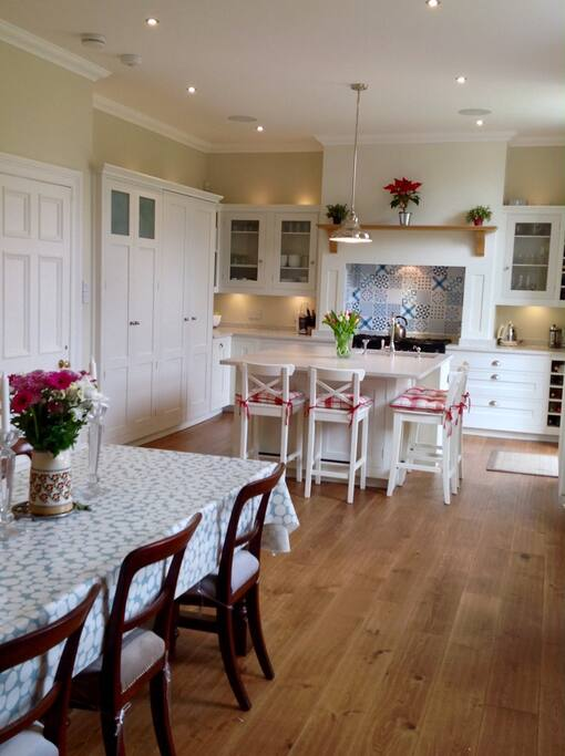 Kitchen/ Dining Room with Sonos speakers.