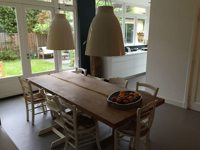 open kitchen with dining table for 10 persons