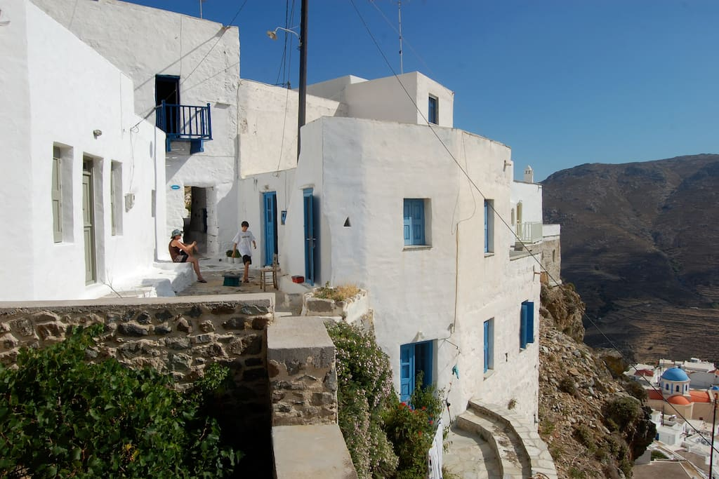 Outside view of the house and upstairs entry in the background is the church and square of Cato Hora