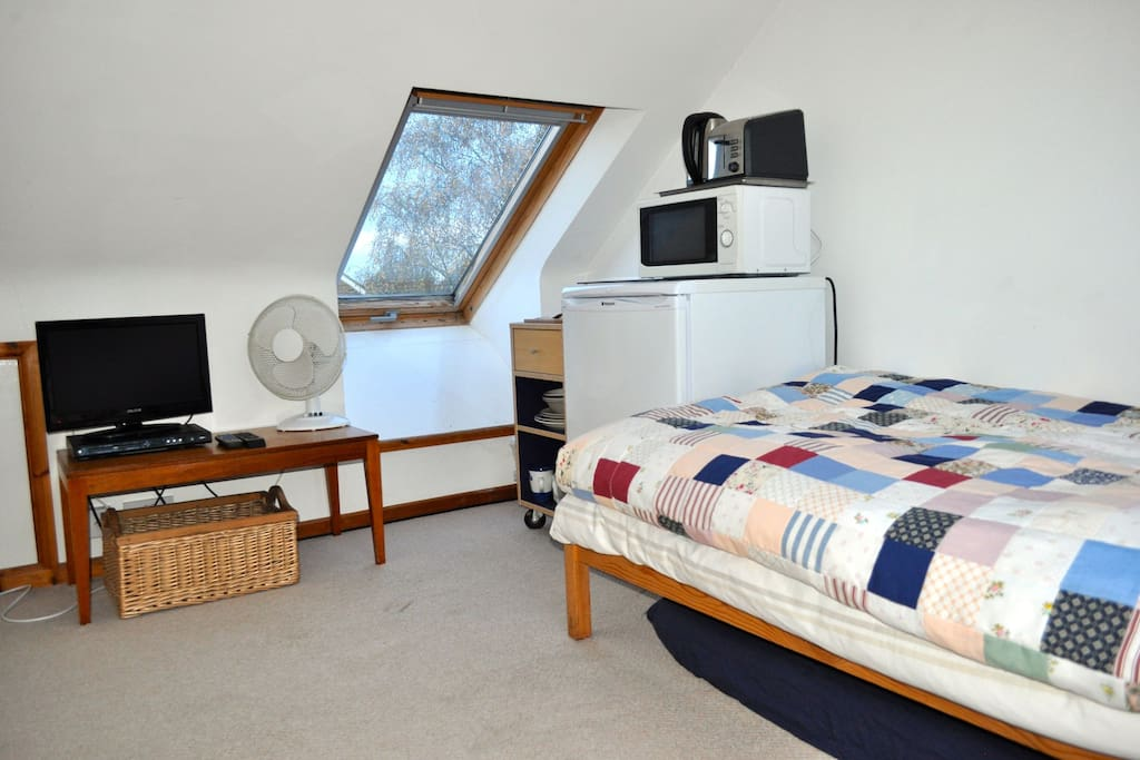 Small attic room, with fridge, microwave, kettle, toaster, TV, DVD player and high speed broadband.