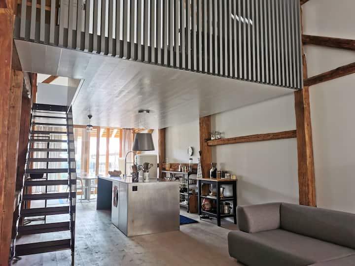 Superbe loft contemporain dans grange rénovée