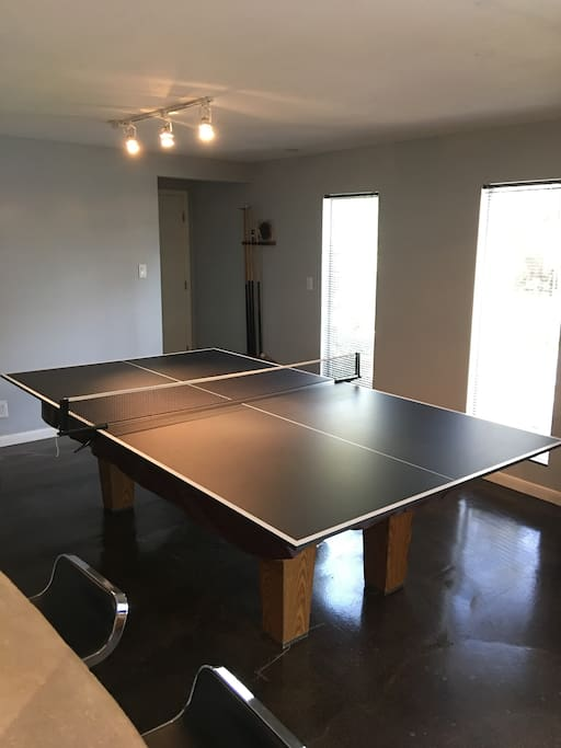 Ping pong table top fits on the pool table.