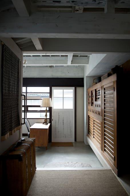 Reception area with impressive old Tansu cupboard .